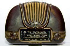 """This streamline/deco radio set was manufactured by Telefunken Radiotécnica Ibérica, Spain, since 1954. Its name was Cariño U1465. In Spanish, cariño means """"sweety""""."""