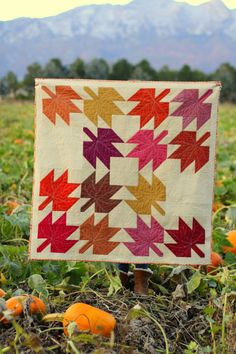 Modern quilt made from traditional Maple Leaf Quilt pattern using Oakshott Rubies fabric. Perfect quilt for fall - link to free pattern included.