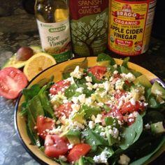 Spinach, tomato, avocado and feta salad with apple cider vinegar, olive oil, rice vinegar and lemon juice dressing