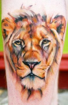 Colorful watercolour lioness tattoo