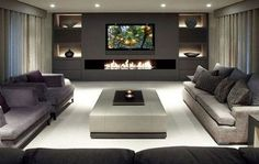 modern finished basement with fireplace stone and tv - Google Search