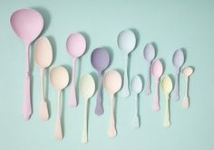 Pastel painted spoons using chalky mild paint.  Hung on the wall they sure make a sweet statement!