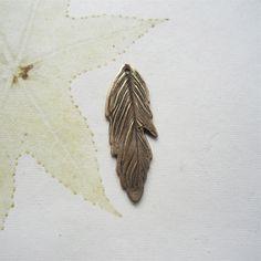 Feather pendant, bronze pendant, bronze jewellery component , nature jewelry. £8.50, via Etsy.