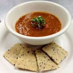 Low fat and heart healthy grilled tomato-basil soup alongside homemade wheat crackers with flax and sesame seeds.  Who knew healthy could taste so good?