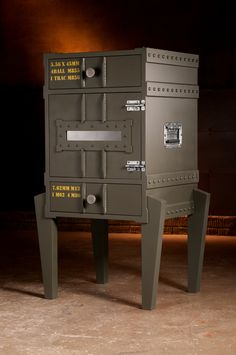 """Gunny.     Overall dimensions: 39.5"""" tall   23"""" wide (at the knees) and 18"""" deep Available from GriffinModern.com"""