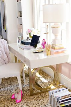 I'm loving this desk. The gold legs are so chic. And the leopard rug underneath is divine.