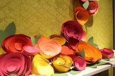 Anthropologie display window with giant paper flowers