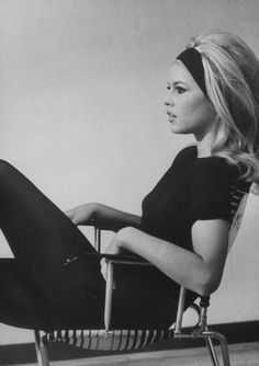 Fitted tops and bottoms. High neckline keeps it classy. Tousled hair keeps it effortless. Brigitte Bardot.