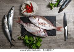 top view of fresh fishes and spices