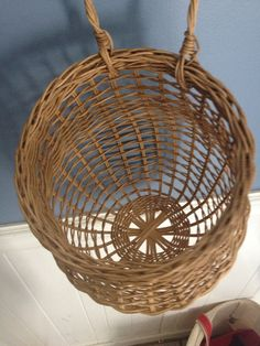 FREE SHIPPING in the US! This is a great basket for storing you onions. It looks nice and doubles as a decoration. This onion basket will hold at least 3lbs of onions. Storing your onions in an onion basket allows air to circulate around the onions keeping them fresh for a long time. This basket was woven by me and stands 10 tall (13 to top if handle). Measures 8 wide at the opening. The basket is finished with a protective stain. Please note that each basket is hand woven and will vary…
