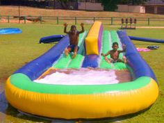 Double Water Slide - An absolute must for the summer month parties. This inflatable consists of two sliding surfaces with an inflated wall in the middle, so two people can slide at the same time and ends in a large pond, which catches the water. Bubble bath can be added to create a fun element. Suitable for kids and adults.