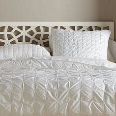 I love white. Our comforter.