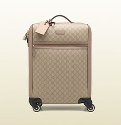 Gucci - four wheel carry-on suitcase 293909AV12G1000