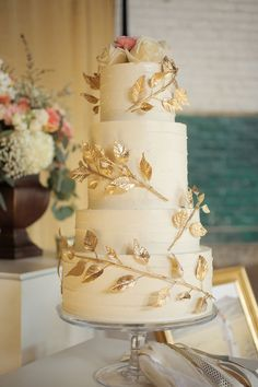 wedding cake with gold detail - photo by Pepper Nix Photography http://ruffledblog.com/handcrafted-wedding-at-trolley-square