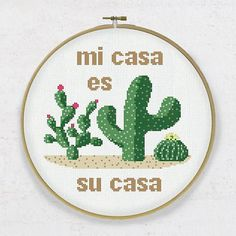 """The cross stitch pdf pattern """"Mi casa es su casa"""" (My home is your home) is a sweet Mexican style welcome sign for your home. Three adorable cactuses with flowers will bring you joy stitching it and a cozy mood to your space. It is a PDF file of the cross stitch PATTERN that is"""