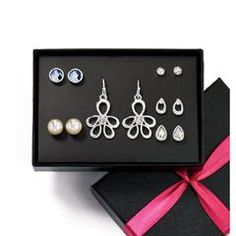 AVON'S Glamour Everyday 6-Piece Earring Set. SPECIAL PRICE ONLY $6.99. Silvertone six pair pierced earring set with faceted faux stones, rhinestones, pearlesque and teardrop shaped studs. One pair of floral earrings with rhinestone drops. • Earrings: 5 pairs are post and earnut clutch / 1 pair are fish hook with rubber stopper clutch • Comes in a black gift box with a pink ribbon inside a plain white box with AVON on the outside. • Imported. ORDER HERE: www.youravon.com/mhamilton39