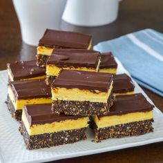 Nanaimo Bars - building a better version of a classic Canadian cookie treat! Nanaimo Bars - building a better version. Try this revamped version of the classic Canadian treat with a more substantial base layer & an improved filling. Vanilla Recipes, Baking Recipes, Sweet Recipes, Easy Recipes, Nanaimo Bars, Köstliche Desserts, Delicious Desserts, Dessert Recipes, Croquembouche