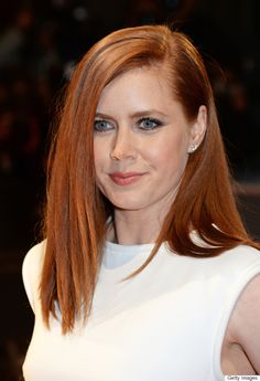 Amy Adams wears her red hair straightened and her locks pop beautifully against her white gown.
