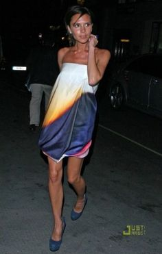 Victoria Beckham wearing Yves Saint Laurent Tribute Two Blue Suede Pumps and Victoria Beckham Twisted Print Corset Dress.