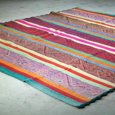 Vintage Peruvian woven rug with brilliant pattern and colors. Great as a rug or throw. 5' x 7' If you're in Austin or Dallas we can drop by and show you rugs in person. Just email us!