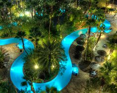 hotel pool Complete with a lazy river, the pool amp; water complex at Tahiti Village is more comparable to a Las Vegas Waterpark than just another hotel pool. Luxury Swimming Pools, Luxury Pools, Dream Pools, Lazy River Pool, Backyard Lazy River, Backyard Pool Designs, Swimming Pool Designs, Backyard Pools, Pool Decks