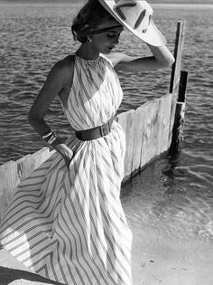 Helen Beatty is wearing summer version of Claire McCardell's tent dress made of a Hope Stillman satin-striped cotton, photo by Herman Landshoff, Oak Beach, New York, Mademoiselle, 1951