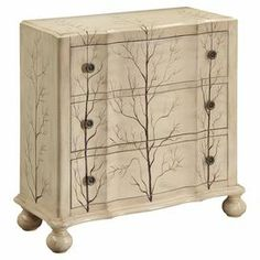 Showcasing artfully hand-painted tree branch silhouettes and an antiqued ivory finish, this 3-drawer chest is perfect for stowing away plush throws and spare linens.  Product: ChestConstruction Material: WoodColor: Weathered ivoryFeatures:  Hand-painted tree motifThree drawersSubtle scallop detailing Dimensions: 32.5'' H x 33.25'' W x 14.5'' D