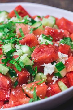 BEST Watermelon Salad, prepared Mediterranean style with cucumber, creamy feta, loads of fresh herbs and a honey-lime dressing. A MUST-TRY! #watermelon #watermelonsalad #mediterraneansalad #mediterraneanfood #mediterraneanrecipes #mediterraneandiet #healthyrecipes #summerrecipes