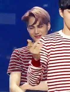 EXO Kai's smirk (gif) lol suho's singing face though