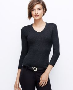 Cast in an array of rich fall colors, this impeccably ribbed sweater endlessly flatters. Team with slim fit styles and simple accessories to keep the look long and lean. V-neck. 3/4 sleeves.