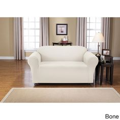 Montgomery One-piece Stretch Sofa Slipcover goes right over your furniture for a fresh new look that costs a lot less.
