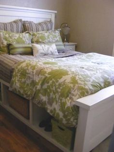 Farmhouse Storage Bed with Hinged Footboard | Do It Yourself Home Projects from Ana White - I MUST make this bed. The only thing I would change it the hinged footboard, I would have open downwards, instead of having to lift it up to access the storage. Love this bed!