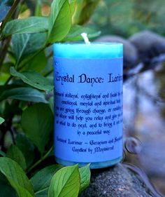 Larimar candle by Candles by Montserrat, with a Larimar chip inside. http://www.thesacredfeminine.com/crystals.html