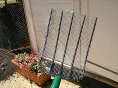 """So why is this wire mesh attached to my pitchfork? Because I've turned our chicken coop into one big litter box. After doing this for the last year or so, I can easily say that this method is a winner. I added a 2-inch layer of coarse sand to the bottom of the coop and use my """"pooper scooper"""" to pick up the poop. And the coop doesn't smell! That's half the battle in keeping critters away. Once a year, clean out all the sand and start over and you're good to go."""