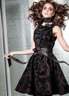 LOOK 3: black cocktail dress with floral texture and flower petal decoration