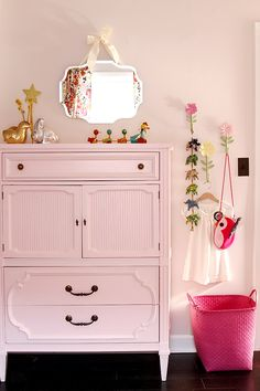 pink girl's bedroom with pink painted vintage dresser #bedrooms #pink