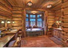 Rustic 3/4 Bathroom with Log house, Flat panel cabinets, Round bathtub, Wood paneling walls, Hardwood floors, Double vanity
