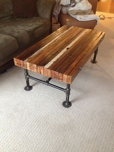 Coffee table made from old 2x4s and black iron pipe