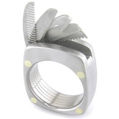 For the Swiss Army knife fanatic groom!     Swiss knife is known for its diverse collection of useful tools, but some craftsmen have produced rings, whose functionality reminiscent of those famous pocket knives.