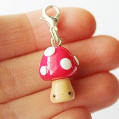This Kawaii Toadstool charm is the perfect accessory to add a touch of cuteness to your life! It is made out of strong oven bake polymer clay. The eyepin (finding) is secured with super glue to ensure durability. It was glazed with a high quality gloss varnish for protection and extra shin...