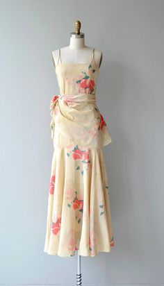 Vintage early 1930s cream silk dress with very bright abstracted floral print, double spahetti straps, straight shape with unfitted waist, ruched side snap closures, fluted hem and detachable wrap peplum. --- M E A S U R E M E N T S --- fits like: extra small bust: best fit up to 32 waist: best fit up to 28 hip: best fit up to 36 length: 55 brand/maker: n/a condition: over all light discoloration on bodice, shown in photos to ensure a good fit, please read the sizing guide: http:...