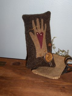 Primitive Wool Applique Heart in Hand Pinkeep design by Maggie Bonanomi