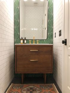 This was a half bath remodel. Floor to ceiling subway tiles with a green sunburst cement tile accent wall. We then added a mid century modern vanity to add warmth to the space. Small Half Bathrooms, Small Half Baths, Small Bathroom, Bathroom Ideas, Tiny Half Bath, Bathroom Organization, Master Bathroom, Cement Tiles Bathroom, Bath Tiles