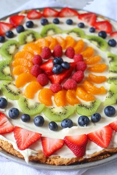 This Sugar Cookie Fruit Pizza recipe is made with a sugar cookie crust, cream cheese frosting, and topped with various fruit of your choice. This is the perfect summer dessert. Sugar Cookie Pizza, Sugar Cookie Dough, Sugar Cookies Recipe, Cookie Recipes, Dessert Recipes, Cookie Crust, Pizza Cookies, Yogurt Recipes, Cookie Desserts