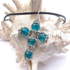 Cross made from bright blue glass beads and bead-caps. € 11,95