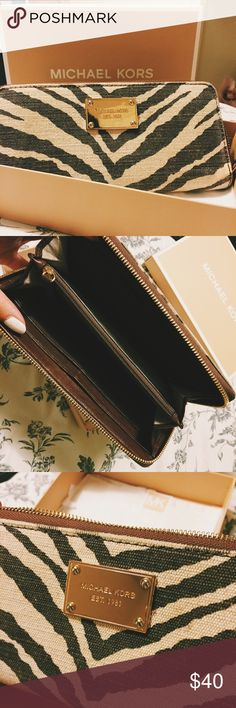 Michael Kora zip around wallet Golden hardware. Exterior golden logo plate at center. Zip pocket splits interior; 8 card slots and 4 bill slots. In great condition, very gently used. Michael Kors Bags Wallets