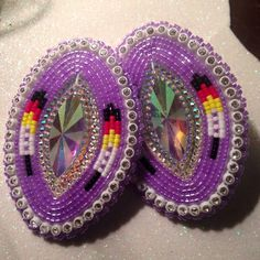 Purple beaded feather design