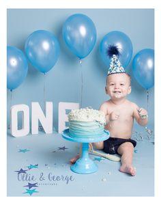 Blue boys ombre cake and balloon background 1st Birthday cake smash photo shoot Ollie and George Photography Studio Blackburn Lancashire