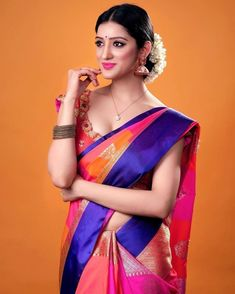 In a orange, pink & dark blue color pattu / kanchipuram saree and elbow length sleeve blouse design with floral design Beautiful Bollywood Actress, Most Beautiful Indian Actress, Beauty Full Girl, Beauty Women, Saree Hairstyles, Saree Blouse Patterns, Saree Dress, Sari, Beautiful Girl Image
