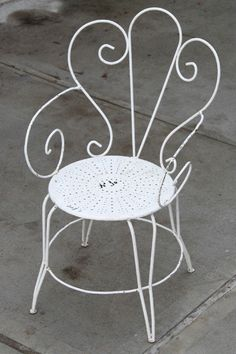 White distressed garden chair by TheTinyFrenchFlea on Etsy https://www.etsy.com/listing/228520132/white-distressed-garden-chair
